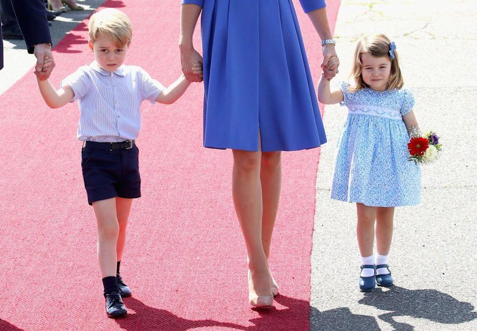 <p>The children joined their parents on their 2017 visit to Germany and Poland, with Charlotte adorably carrying a bunch of flowers after arriving at Berlin airport.</p>