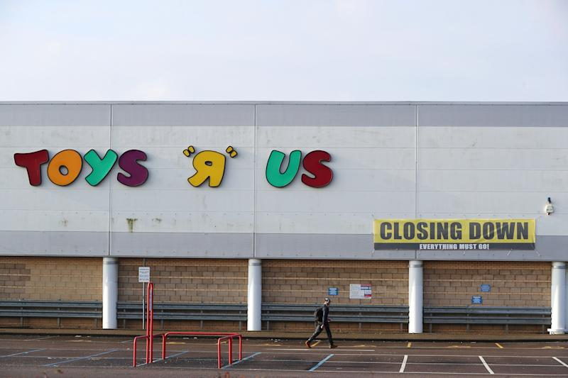 Closing down signs are seen outside the Toys R Us store in Coventry Britain