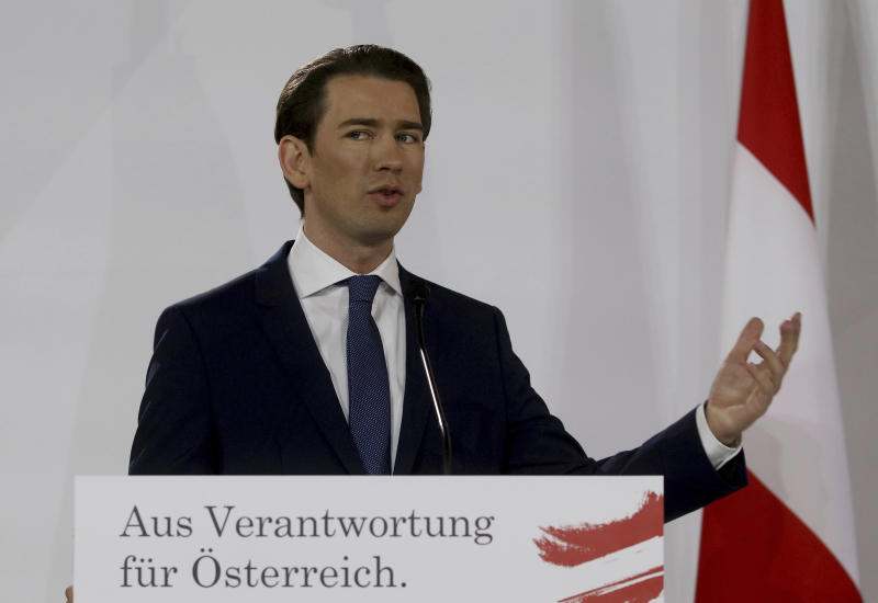 """Sebastian Kurz head of the Austrian People's Party, OEVP, speaks to journalists during a press conference about the government program with Werner Kogler head of the Austrian Greens in Vienna, Austria, Thursday, Jan. 2, 2020. The banner reads """"To responsibility for Austria"""". (AP Photo/Ronald Zak)"""