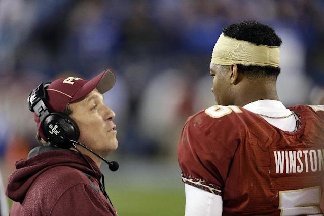 FILE - In this file photo from Dec. 7, 2013, Florida State head coach Jimbo Fisher, left, talks with quarterback Jameis Winston in the closing minutes of the Atlantic Coast Conference Championship NCAA football game against Duke in Charlotte, N.C. Florida State defeated Duke 45-7. The No. 1-ranked Florida State held their final workout on campus Monday, Dec. 30 2013, before flying to California to face No. 2 Auburn in the BCS NCAA college football championship game. (AP Photo/Bob Leverone, file)