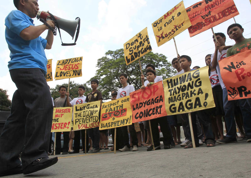 "Filipino Christian youths display placards during a rally, calling for the cancellation of Lady Gaga's May 21-22 concerts, outside the Pasay City Hall in Pasay, south of Manila, Philippines, Friday, May 18, 2012. The youths said they are offended by Lady Gaga's music and videos, in particular her song ""Judas"" which they say mocks Jesus Christ. Lady Gaga's concert was marked also by protest from evangelical groups in South Korea and the singer scrapped an Indonesia concert following protests from conservative Muslims. (AP Photo/Bullit Marquez)"