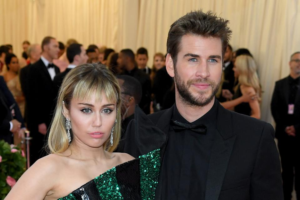 NEW YORK, NEW YORK - MAY 06: Miley Cyrus and Liam Hemsworth attend The 2019 Met Gala Celebrating Camp: Notes On Fashion at The Metropolitan Museum of Art on May 06, 2019 in New York City. (Photo by Karwai Tang/WireImage )