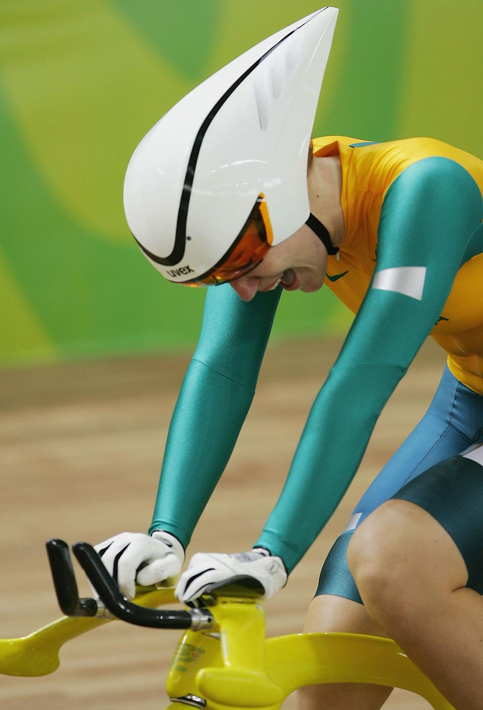 ATHENS - AUGUST 20: Anna Meares of Australia celebrates after finishing first and winning the gold medal in the women's track cycling 500 metre time trial final on August 20, 2004 during the Athens 2004 Summer Olympic Games at the Olympic Velodrome within the Olympic Sports Complex in Athens, Greece. (Photo by Donald Miralle/Getty Images)
