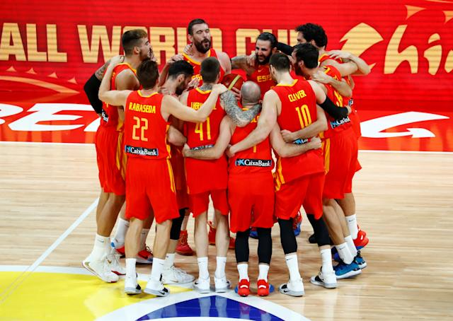 Basketball - FIBA World Cup - Final - Argentina v Spain - Wukesong Sport Arena, Beijing, China - September 15, 2019 Spain players team huddle to celebrate winning the match REUTERS/Thomas Peter