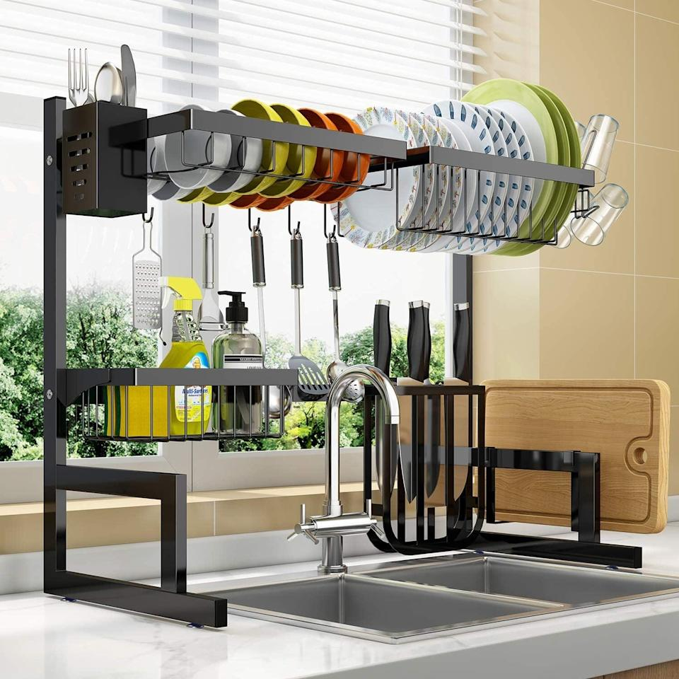 <p>Make use of verticle space in your kitchen with this <span>Over the Sink Adjustable Dish Drying Rack</span> ($40, originally $80). It's a two-tier expandable dish drying rack that has ten utility hooks.</p>