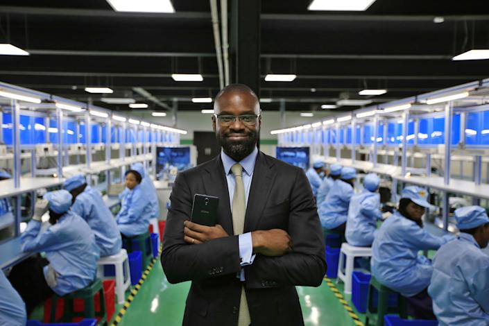 Lekan Akinjide, AfriOne's director of strategy and government coordination, on the production floor at the new AfriOne manufacturing plant in Lagos in April 2017. The plant can produce some 120,000 units per month. (Photo: George Osodi/Bloomberg via Getty Images)
