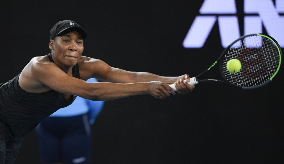 United States' Venus Williams makes a backhand return to Petra Kvitova of the Czech Republic during a tuneup tournament ahead of the Australian Open tennis championships in Melbourne, Australia, Tuesday, Feb. 2, 2021. (AP Photo/Andrew Brownbill)