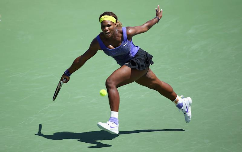 Serena Williams hits a return during her match against Samantha Stosur of Australia during a match on day 5 at Western & Southern Open on August 13, 2014 at the Linder Family Tennis Center in Cincinnati, Ohio