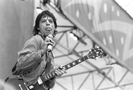 Mick Jagger, lead singer of the Rolling Stones, performs at Paris's Auteuil Hippodrome in 1982. The Rolling Stones launch a photographic exhibition Thursday marking 50 years since their first gig, as guitarist Keith Richards said the veteran British rock band had been rehearsing again