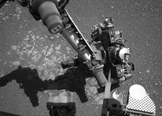 The image from Curiosity's left navcam at the same time shows the craft was attempting to take a self-portrait over the Martian terrain (Nasa)