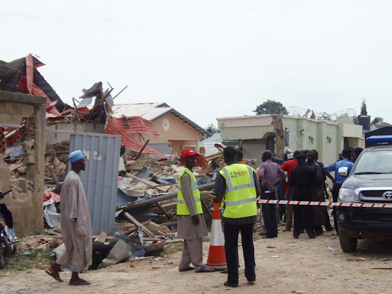 National Emergency Management Agency personnel secure the area after a 2012 bomb blast in Zaria, northern Nigeria