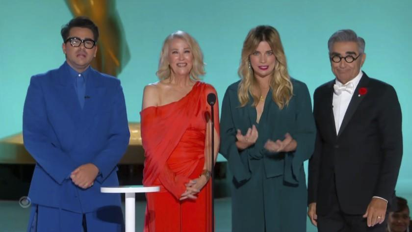 In this video grab issued Sunday, Sept. 19, 2021, by the Television Academy, Dan Levy, Catherine O'Hara, Annie Murphy and Eugene Levy present the award for outstanding writing for a comedy series during the Primetime Emmy Awards. (Television Academy via AP)