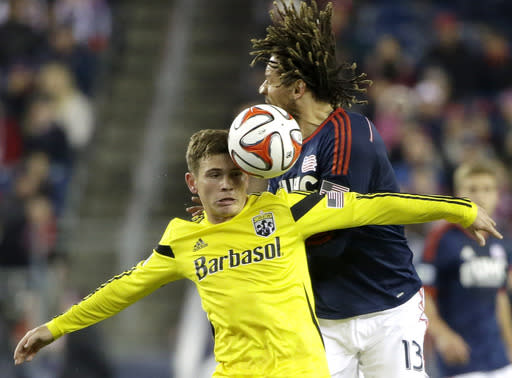 Columbus Crew midfielder Wil Trapp, left, and New England Revolution midfielder Jermaine Jones, right, vie for control of the ball during the first half of an MLS soccer playoff game, Sunday, Nov. 9, 2014, in Foxborough, Mass. (AP Photo/Steven Senne)
