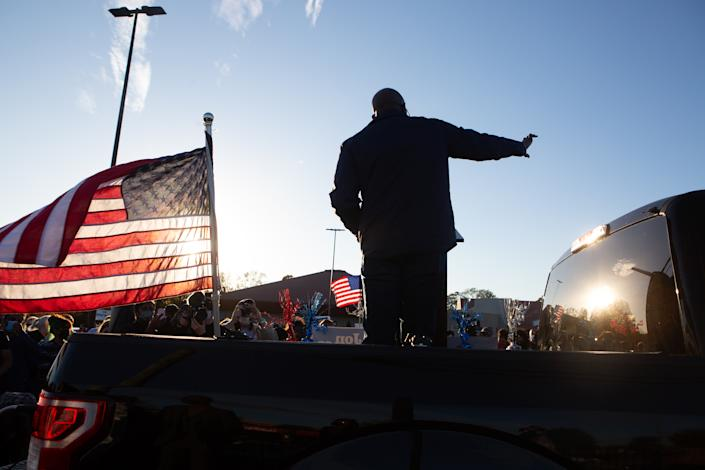 Raphael Warnock, the Democratic candidate for the U.S. Senate of Georgia, speaks to supporters at a rally in Marietta, Georgia, November 15, 2020.  (Photo courtesy of Jessica McGowan/Getty Images)