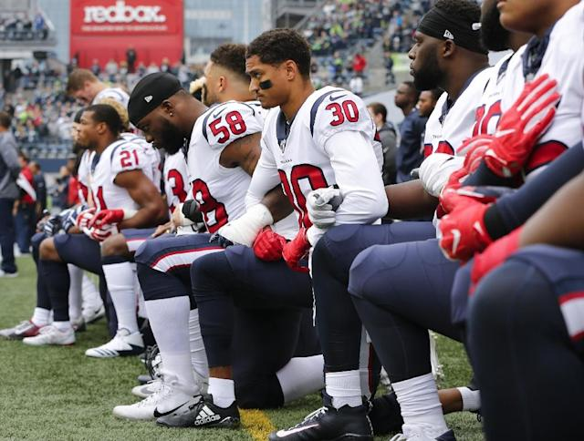 Under the National Football League's new policy, players who go onto the field and don't stand for the national anthem face a punishment (AFP Photo/JONATHAN FERREY)