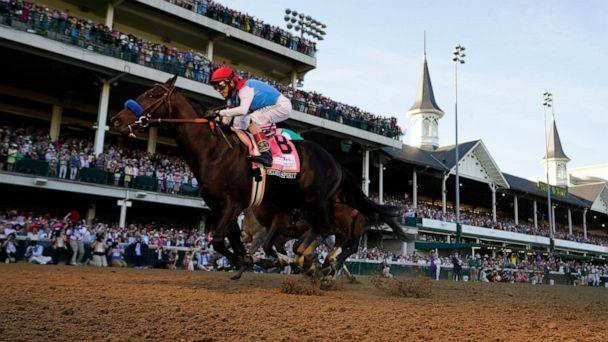 PHOTO: John Velazquez rides Medina Spirit across the finish line to win the 147th running of the Kentucky Derby at Churchill Downs, May 1, 2021, in Louisville, Ky. (Jeff Roberson/AP)