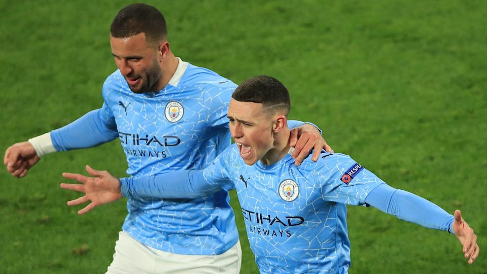 Manchester City's Phil Foden (right) celebrates after scoring a goal against Borussia Dortmund in the second leg of their UEFA Champions League quarterfinal.
