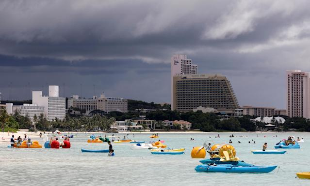 <p>Tourists frolic on the waters overlooking posh hotels in Tumon tourist district on the island of Guam, a U.S. Pacific Territory, August 10, 2017. (Erik De Castro/Reuters) </p>