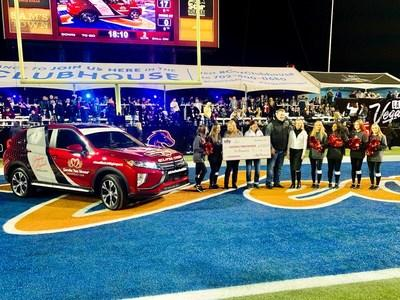 """Halftime at the 2019 Mitsubishi Motors Las Vegas Bowl: Mitsubishi Motors and Ally Financial present a 2020 Mitsubishi Eclipse Cross """"Community Utility Vehicle"""" and $10,000 to Nikki and Tony Berti, founders of the Goodie Two Shoes Foundation, which provides shoes and socks to disadvantaged children in Southern Nevada."""