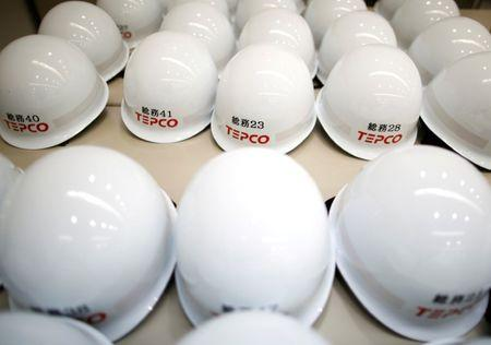 FILE PHOTO: Logo of TEPCO is seen on helmets at TEPCO's South Yokohama Thermal Power Station in Yokohama