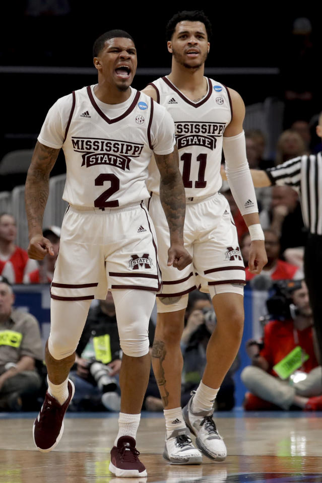 Mississippi State guard Lamar Peters, left, celebrates after scoring during the second half against Liberty in a first-round game in the NCAA mens college basketball tournament Friday, March 22, 2019, in San Jose, Calif. (AP Photo/Jeff Chiu)