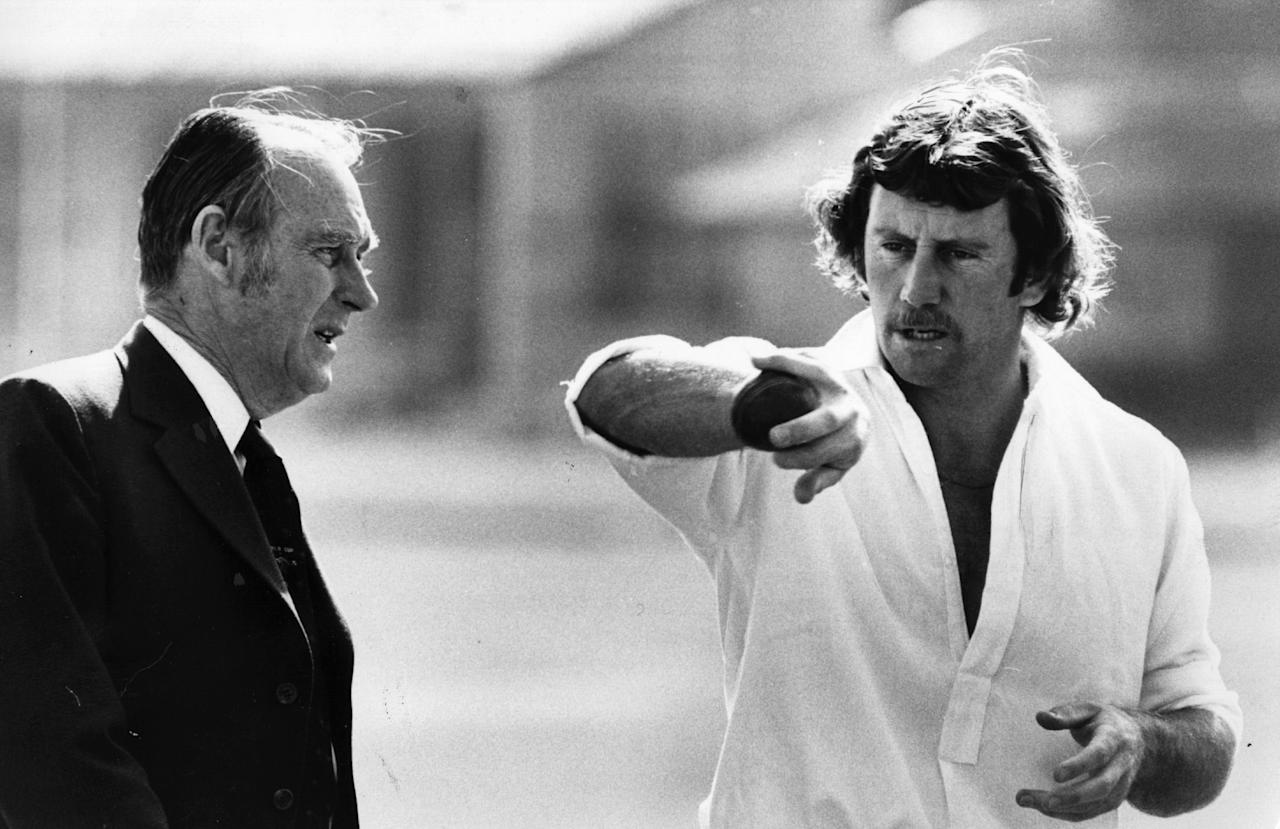 1975:  Australian cricket captain Ian Chappell tries out an odd grip on the ball with his manager Fred Bennett.  (Photo by Milton Wordley/Evening Standard/Getty Images)