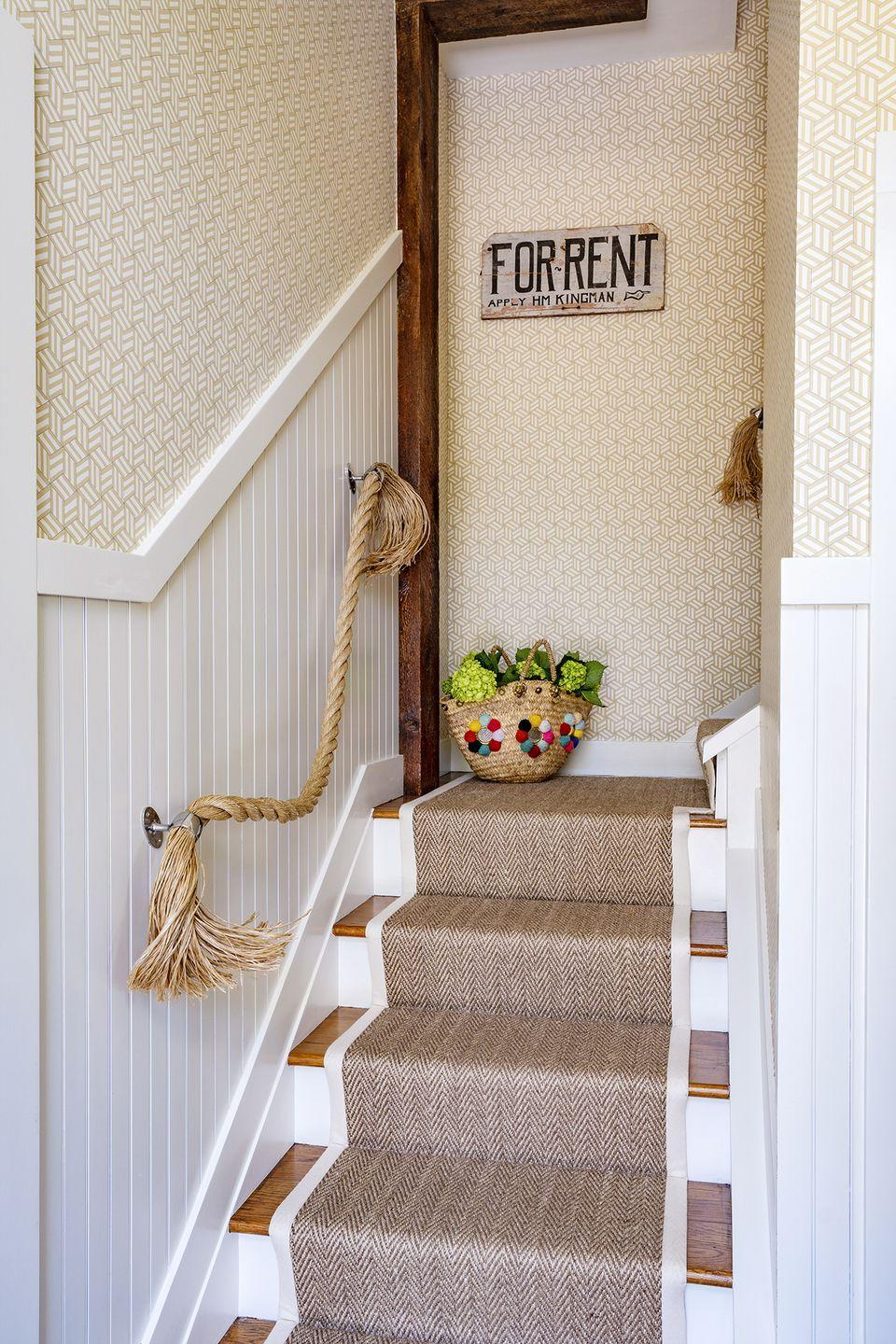 <p>Trade out a standard wooden bannister for jute or Pro-Manila rope to match your home's nautical aesthetic. After anchoring brackets to the wall or individual posts, secure the rope from the top to the bottom of the stairs. Then unravel both ends to create a more relaxed look. </p>