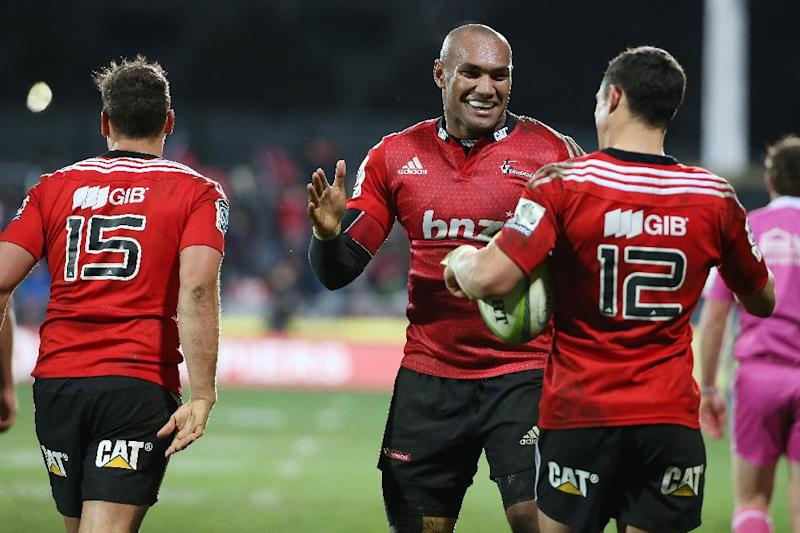 Canterbury Crusaders' Nemani Nadolo (C) celebrates a try with teammate Dan Carter during their Super 15 semi-final match against the Coastal Sharks in Christchurch on July 26, 2014