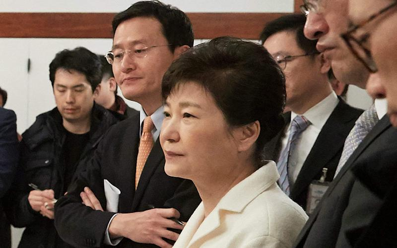 In this photo provided by the South Korean Presidential House, impeached South Korean President Park Geun-hye, center, lists to questions during a meeting with a selected group of reporters - Credit:  The South Korean Presidential House