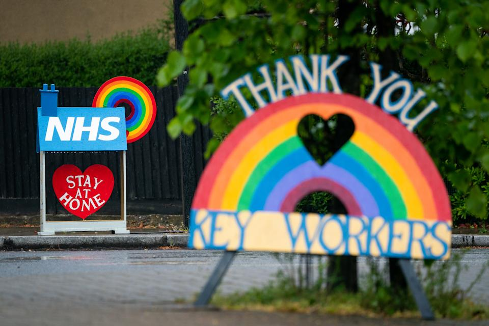 Signs thanking key workers and the NHS are seen in South London as the UK continues in lockdown to help curb the spread of the coronavirus.