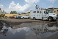 Emergency vehicles respond to evacuate people at a mass shelter Thursday, Sept. 2, 2021 in Independence, La. Multiple nursing home residents died after Hurricane Ida, but full details of their deaths are unknown because state health inspectors said Thursday that they were turned away from examining conditions at the facility to which they had been evacuated. (Chris Granger/The Times-Picayune/The New Orleans Advocate via AP)