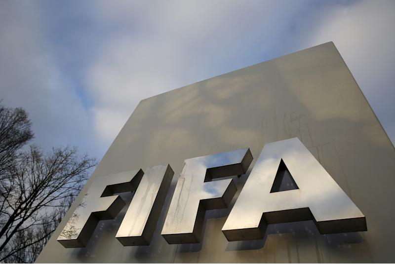 A FIFA sign is seen outside the FIFA headquarters in Zurich, Switzerland December 17, 2015. REUTERS/Ruben Sprich