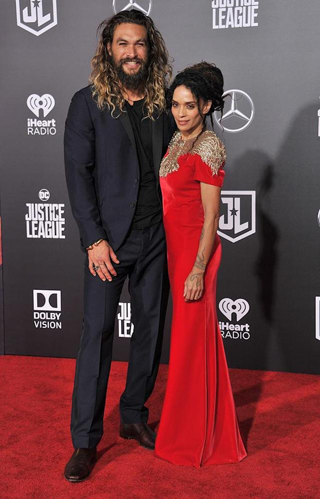 """<p>The gorgeous duo walked the red carpet for the first time as a married couple at the premiere of <em>Justice League</em> on Monday. Together for 12 years, Momoa and Bonet <a href=""""https://www.yahoo.com/entertainment/jason-momoa-lisa-bonet-tie-232313313.html"""" data-ylk=""""slk:tied the knot;outcm:mb_qualified_link;_E:mb_qualified_link"""" class=""""link rapid-noclick-resp newsroom-embed-article"""">tied the knot</a> in early October. (Photo: Gregg DeGuire/WireImage) </p>"""