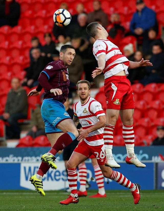Soccer Football - FA Cup Second Round - Doncaster Rovers vs Scunthorpe United - Keepmoat Stadium, Doncaster, Britain - December 3, 2017 Scunthorpe United's Andrew Crofts (L) in action with Doncaster Rovers' Ben Whiteman Action Images/Craig Brough