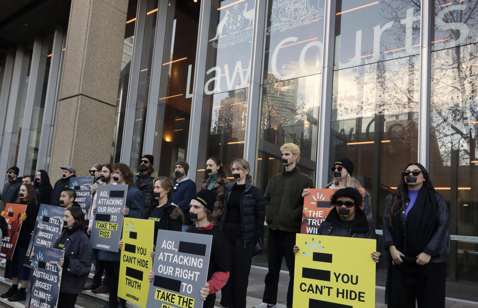 """Greenpeace supporters demonstrate outside the Federal Court in Sydney, Wednesday, June 2, 2021. Australia's largest electricity generator on Tuesday, June 8, 2021, largely lost its court case alleging that the environmental group Greenpeace had breached copyright and trademark laws by using its logo in a campaign that described the company as the nation's """"biggest climate polluter."""" (AP Photo/Rick Rycroft)"""