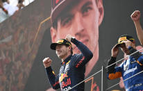 Red Bull driver Max Verstappen of the Netherlands jubilates on the podium after winning the Austrian Formula One Grand Prix at the Red Bull Ring racetrack in Spielberg, Austria, Sunday, July 4, 2021. (Christian Bruna/Pool Photo via AP)