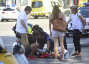 <p>An injured person is treated in Barcelona, Spain, Aug. 17, 2017 after a white van jumped the sidewalk in the historic Las Ramblas district, crashing into a summer crowd of residents and tourists and injuring several people, police said. (AP Photo/Oriol Duran) </p>