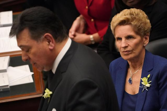 Ontario Premier Kathleen Wynne watches Finance Minister Charles Sousa as he reads portions of the new provincial budget at Queen's Park in Toronto, Ontario, Canada, March 28, 2018. REUTERS/Carlo Allegri