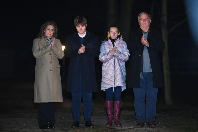 Captain Sir Tom Moore's daughter Hannah Ingram-Moore, grandson Benji, granddaughter Georgia and son-in-law Colin Ingram outside his the home in Marston Moretaine, Bedfordshire
