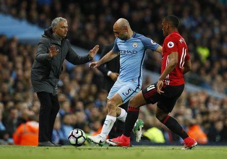 Britain Soccer Football - Manchester City v Manchester United - Premier League - Etihad Stadium - 27/4/17 Manchester City's Pablo Zabaleta in action with Manchester United's Anthony Martial as Manchester United manager Jose Mourinho looks on Action Images via Reuters / Jason Cairnduff Livepic