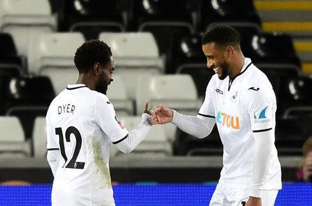 Soccer Football - FA Cup Fourth Round Replay - Swansea City vs Notts County - Liberty Stadium, Swansea, Britain - February 6, 2018 Swansea City's Nathan Dyer celebrates scoring their third goal with Luciano Narsingh REUTERS/Rebecca Naden