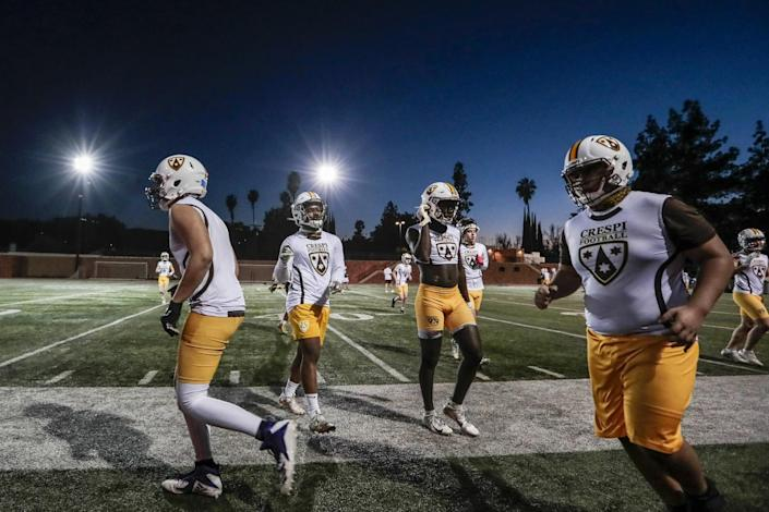 Culver City players go through the paces during their first practice in 11 months.