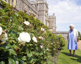 Britain's Queen Elizabeth II inspects a rose border after receiving a Duke of Edinburgh rose, at Windsor Castle, England, Wednesday June 9, 2021. The newly bred deep pink commemorative rose has officially been named in memory of the late Prince Philip Duke of Edinburgh. A royalty from the sale of each rose will go to The Duke of Edinburgh's Award Living Legacy Fund to support young people taking part in the Duke of Edinburgh Award scheme. (Steve Parsons/Pool via AP)