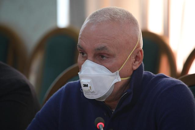 Businessman Oleksandr Yaroslavsky is pictured wearing a mask during a briefing on the coronavirus in Kharkiv, Ukraine, on 24 March. Since the outbreak was identified, 97 cases have been confirmed in Ukraine. (Getty Images)
