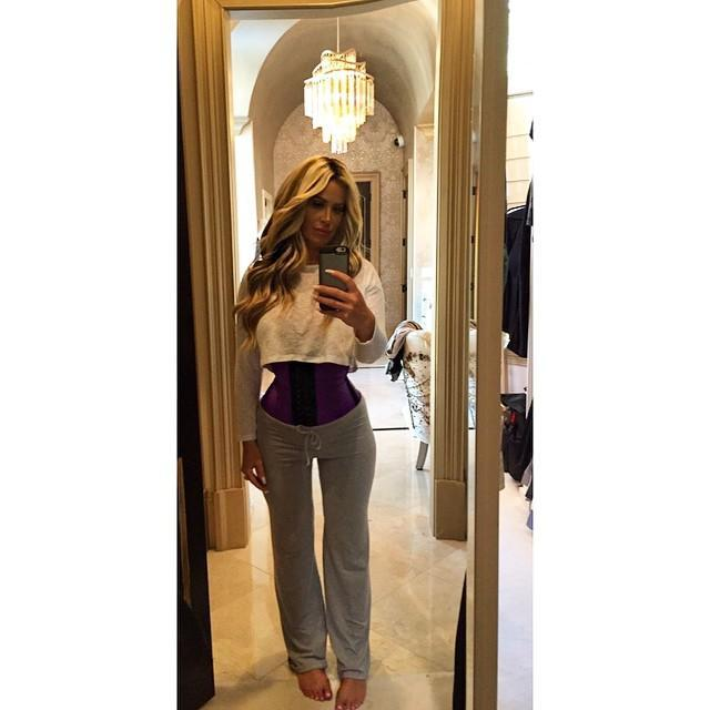 """How small can Kim Zolciak's waist get?! The former <em>Real Housewives of Atlanta </em>star, who already shocked her fans in March with her alarmingly tiny waist, recently Instagrammed that she lost four inches off her waist due to the celebrity-endorsed waist-training trend. <strong>PHOTOS: Celebs In Their Underwear</strong> And in case you think the 37-year-old mother of six is Photoshopping her jaw-dropping pics, she also shot a video proving her results. """"Sooooo I made a video since most of you think I photoshop my pics! I don't cause I don't need to!"""" she wrote. """"I have horrible posture (carrying the twins did me in) and it really helps that too at least for me. I recommend the waist trainer because it works so well for me and I like to share with you guys what products I love since there are so many out there!"""" But even if waist training is endorsed by seemingly everyone from Kim and Khloe Kardashian, to Ciara, to Jessica Alba, wearing a super-tight corset also has some serious risks. According to <em>Yahoo Health</em>, wearing the constricting undergarment can result in acid reflux, bruising of your bones, oxygen shortage, cause problems with blood clots, and in more serious cases, even harm the spleen and cause trouble to kidneys. And it might not even work. """"Wearing a corset won't make you lose fat around your waist,"""" Holly Phillips, MD, a New York City-based internist, tells <em>Yahoo Health</em>. """"What is a myth is that you can change your bone structure by wearing them. For [adult] women, your bones are formed. You can bruise them and harm them, but you can't change them."""" """"The corset itself doesn't have any direct effect on your fat or anatomy,"""" adds Andrew Miller, MD, a New York City-based plastic surgeon. """"If you stopped wearing a corset, eventually you're just going to return to the way you were."""" <strong>PHOTO: The Already Super-Slim Ciara Joins the Waist Training Trend</strong> Check out eight celebrities who swear by waist training in the video be"""