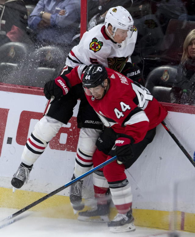 Ottawa Senators centre Jean-Gabriel Pageau (44) collides with Chicago Blackhawks defenceman Connor Murphy along the boards during second period NHL hockey action in Ottawa, Tuesday, Jan. 14, 2020. (Adrian Wyld/The Canadian Press via AP)