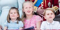 <p>Prince George and Princess Charlotte pose with cousin Savannah Phillips and the rest of the royal family on the balcony of Buckingham Palace for Trooping the Colour. </p>