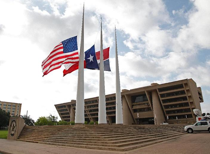Flags fly at half mast at Dallas City Hall following the fatal shootings of five police officers on July 8, 2016 (AFP Photo/Stewart F. House)
