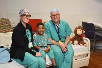 Five-year-old Jaycob James at St. Joseph's Children's Hospital in Tampa with Jennifer Carter, DNP, APRN, CPNP-AC, and Dr. Jeremy Ringewald, pediatric interventional cardiologist and the medical director of the Cardiac Catheterization Lab at St. Joseph's Children's Hospital. Jaycob was born with an atrial septal defect and was among the first patients in Florida to have his heart repaired using a new, next-generation medical device.