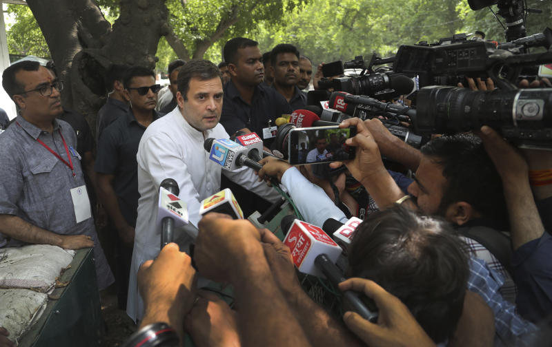 Congress party president Rahul Gandhi, center, talks to media outside his home after casting his vote during the sixth phase of general elections in New Delhi, India, Sunday, May 12, 2019. Indians are voting in the next-to-last round of 6-week-long national elections, marked by a highly acrimonious campaign with Prime Minister Narendra Modi flaying the opposition Congress party rival Rahul Gandhi's family for the country's ills. (AP Photo/Manish Swarup)
